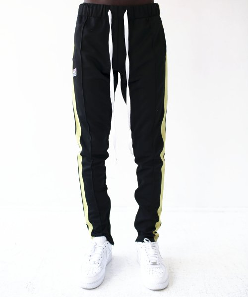 알에스원(R.S.1NE) CONTRAST COLOR TRACK PANTS(BLACKNEON)