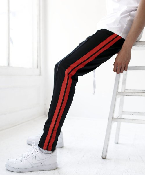 알에스원(R.S.1NE) CONTRAST COLOR TRACK PANTS(BLACKORANGE)